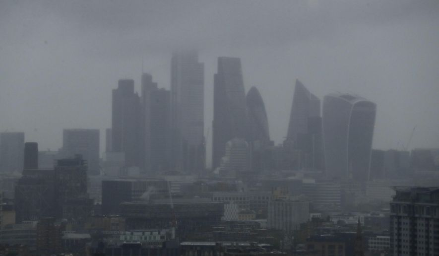 The skyline is seen through the rain and mist in London, Monday June 10, 2019. (AP Photo/Matt Dunham)
