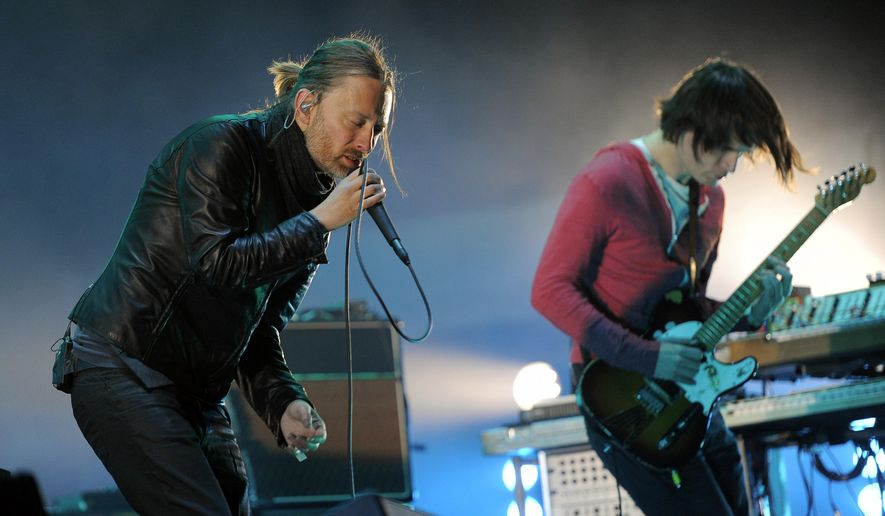 In this April 14, 2012, file photo, Thom Yorke, left, and Jonny Greenwood of Radiohead perform during the band's headlining set at the 2012 Coachella Valley Music and Arts Festival in Indio, Calif. (AP Photo/Chris Pizzello, File)