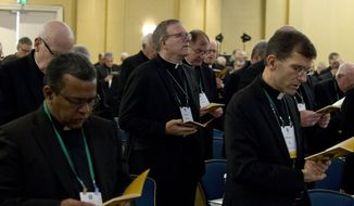 """Auxiliary Bishop Robert Barron of Los Angeles (center) is reaching out to millennial and Generation Z """"nones."""" (Associated Press/File)"""