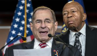 House Judiciary Committee Chairman Jerrold Nadler, D-N.Y., joined at right by House Oversight and Reform Committee Chairman Elijah E. Cummings, D-Md., talks to reporters after passage of a resolution to take legal action against President Donald Trump's administration and potential witnesses, a response to those who defy subpoenas in Congress' Russia probe and other investigations, on Capitol Hill in Washington, Tuesday, June 11, 2019.  (AP Photo/J. Scott Applewhite)