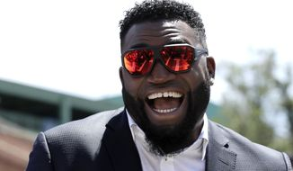 In this June 22, 2017, file photo, retired Boston Red Sox designated hitter David Ortiz, smiles outside Fenway Park in Boston. Ortiz returned to Boston for medical care after being shot in a bar Sunday, June 9, 2019, in his native Dominican Republic. (AP Photo/Charles Krupa, File) **FILE**