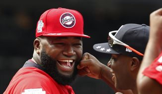 In this July 15, 2018, file photo, World Team Manager David Ortiz (34) speaks with U.S. Team Manager Torrii Hunter, before the All-Star Futures baseball game at Nationals Park, in Washington. Ortiz returned to Boston for medical care after being shot in a bar Sunday, June 9, 2019, in his native Dominican Republic. (AP Photo/Alex Brandon, File) **FILE**