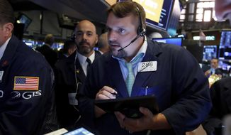 FILE - In this June 6, 2019, file photo trader Michael Milano, right, works on the floor of the New York Stock Exchange. U.S. stocks marched higher in early trading Tuesday, June 11, on Wall Street and extended a winning streak that has recouped much of May's sharp losses. (AP Photo/Richard Drew, File)