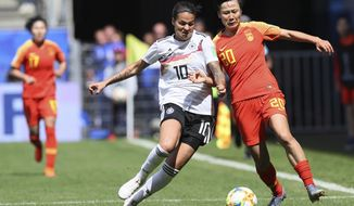 Germany's Dzsenifer Marozsan, left, and China's Zhang Rui fight for the ball during the Women's World Cup Group B soccer match between Germany and China, at the Roazhon Park stadium, in Rennes, France, Saturday, June 8, 2019. (AP Photo/David Vincent)