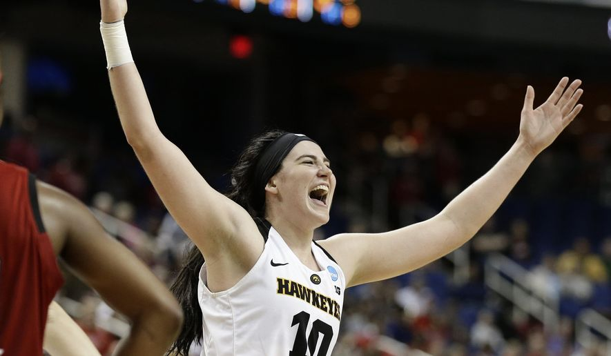 FILE - In this March 30, 2019, file photo, Iowa's Megan Gustafson reacts as she leaves the court during the second half of a regional women's college basketball game against North Carolina State in the NCAA Tournament in Greensboro, N.C. Former Iowa star Gustafson was drafted by the WNBA Dallas Wings before getting cut just before final rosters were announced. The AP Player of the Year will be competing with an Iowa alumni team in The Basketball Tournament. (AP Photo/Gerry Broome, File)