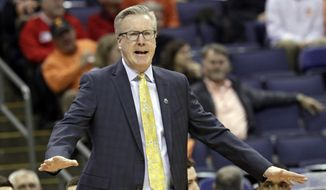 FILE - In this March 22, 2019, file photo, Iowa head coach Fran McCaffery yells instructions to players in the first half against Cincinnati during a first round men's college basketball game in the NCAA Tournament in Columbus, Ohio. Defections, transfers and a key injury made this the most chaotic offseason in coach Fran McCaffery's decade-long tenure at Iowa. But that doesn't necessarily mean the Hawkeyes are in for a down season in 2019-20. (AP Photo/Tony Dejak, File)