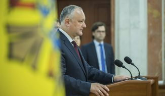Moldova's President Igor Dodonin delivers a brief statement after a meeting of the country's Supreme Security Council in Chisinau, Moldova, Tuesday, June 11, 2019. Dodon, who is temporarily suspended from his duties by Moldova's constitutional court who appointed an interim president, called the decision anti-constitutional. (AP Photo/Roveliu Buga)