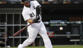 Chicago White Sox's Welington Castillo swings into a grand slam off Washington Nationals starting pitcher Patrick Corbin during the first inning of a baseball game Tuesday, June 11, 2019, in Chicago. (AP Photo/Charles Rex Arbogast) ** FILE **