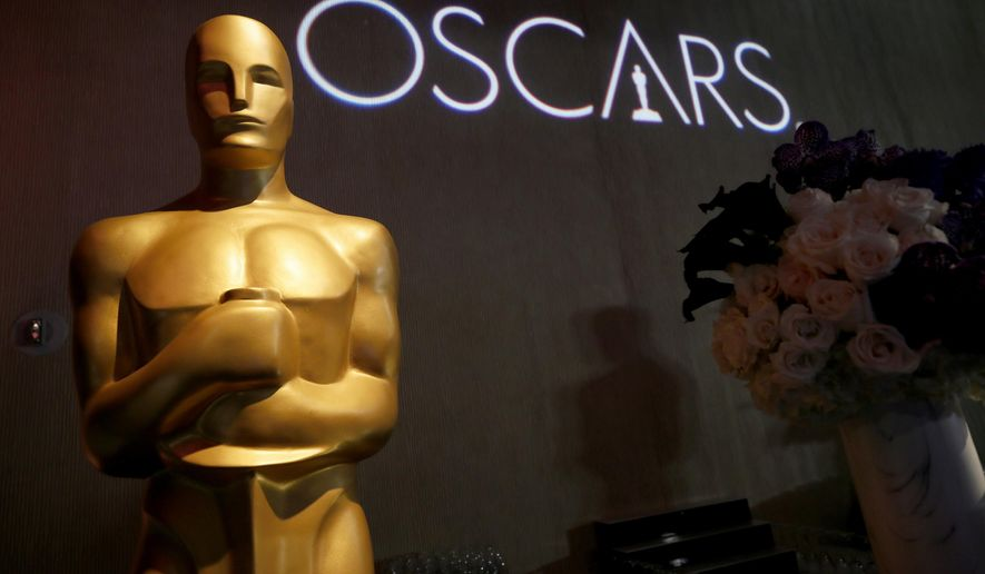 FILE - In this Feb. 4, 2019 file photo, the Oscar statue appears the 91st Academy Awards Nominees Luncheon at The Beverly Hilton Hotel in Beverly Hills, Calif.  The Academy of Motion Picture Arts and Sciences has set the date for the 94th Oscars. The film academy says Tuesday, June 11, 2019  that the ceremony will be held on Feb. 27, 2022, airing live on ABC at 8 p.m ET.(Photo by Danny Moloshok/Invision/AP, file)