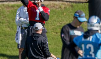 Carolina Panthers quarterback Cam Newton passes during an NFL football team practice in Charlotte, N.C., Tuesday, June 11, 2019. (AP Photo/Nell Redmond)