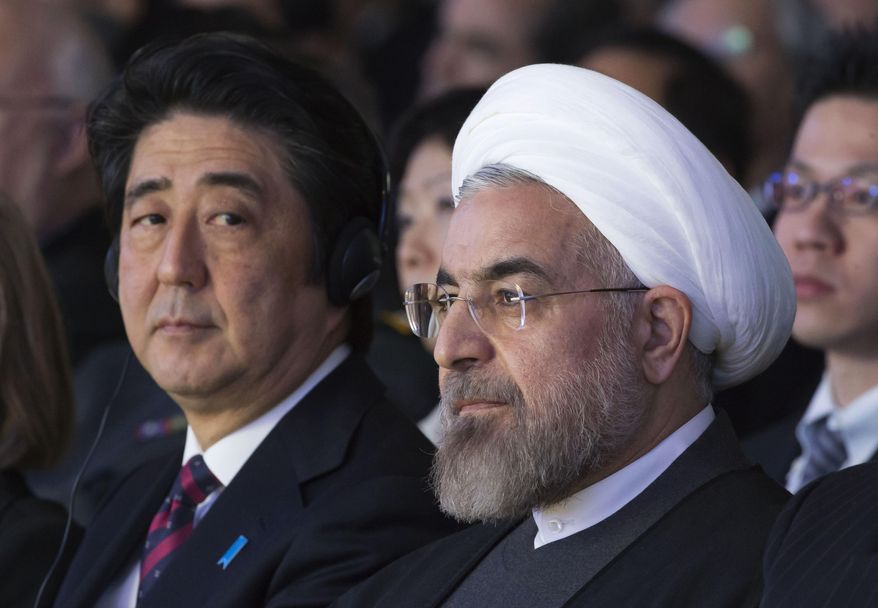 In this Jan. 22, 2014, file photo, Japanese Prime Minister Shinzo Abe, left, and Iranian President Hassan Rouhani, attend a session of the World Economic Forum in Davos, Switzerland. Abe's trip to Tehran on Wednesday, June 12, 2019, represents the highest-level effort yet to de-escalate tensions between the U.S. and Iran. The visit comes as Iran appears poised to break the 2015 nuclear deal it struck with world powers that America earlier abandoned. (AP Photo/Michel Euler, File)