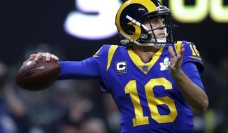 FILE - In this Sunday, Feb. 3, 2019 file photo, Los Angeles Rams' Jared Goff drops back to pass against the New England Patriots during the second half of the NFL Super Bowl 53 football game in Atlanta. Goff insists he feels no urgency to reach a contract extension with the Rams heading into his fourth season with the club, even after Carson Wentz reached a big-money deal with the Philadelphia Eagles earlier in the offseason. The former No. 1 draft pick led the Rams to the Super Bowl last season. (AP Photo/Carolyn Kaster, File)