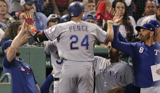 Texas Rangers' Hunter Pence (24) is congratulated after his inside the park home run in the sixth inning of a baseball game against the Boston Red Sox at Fenway Park in Boston, Tuesday, June 11, 2019. (AP Photo/Charles Krupa)