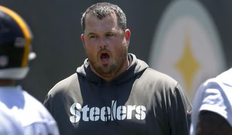 Pittsburgh Steelers offensive line coach Shaun Surratt, gives directions during an NFL football practice at the team's training facility, Tuesday, June 11, 2019, in Pittsburgh. Surratt, the first-year Pittsburgh Steelers offensive line coach, has to try to fill the shoes of Hall of Famer Mike Munchak, who left in the offseason for the same job with the Denver Broncos. (AP Photo/Keith Srakocic)