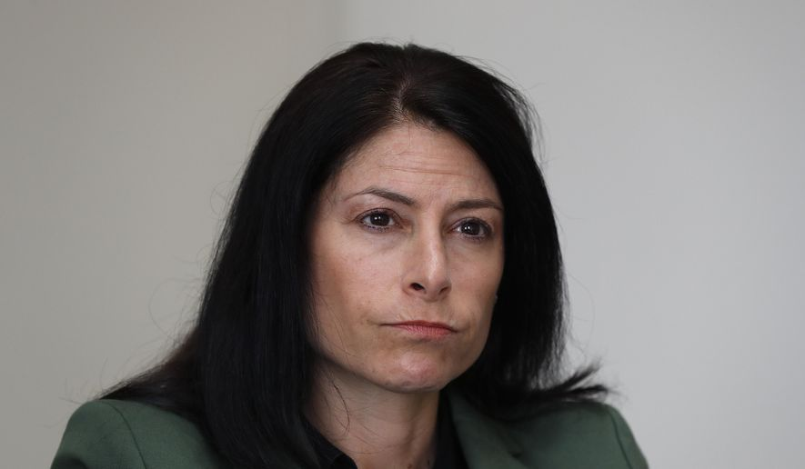 """In this June 4, 2019, photo, Dana Nessel, attorney general of Michigan, listens to a question from reporters in Detroit. Hundreds of boxes. Millions of records. From Texas to Michigan this month, attorneys general are sifting through """"secret"""" files, nondisclosure agreements between the church and families, heart-wrenching letters from parents begging for action, priests' own psychiatric evaluations. They're looking to prosecute, and not just priests. (AP Photo/Paul Sancya)"""