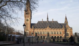 FILE - This Monday, Feb. 18, 2019 file photo shows an exterior view of the Peace Palace, which houses the International Court of Justice, or World Court, in The Hague, Netherlands. Russia has urged an international arbitration panel to throw out a case filed by Ukraine linked to mineral and fishing rights in waters around the Crimean Peninsula. Preliminary hearings that started Monday June 10, 2019 in The Hague stem from Russia's 2014 annexation of Crimea, a move that Ukraine and most of the world view as illegal. (AP Photo/Peter Dejong, File)