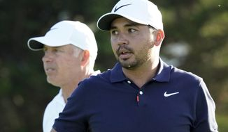 Jason Day, of Australia, and caddie Steve Williams walk on the 13th hole during a practice round for the U.S. Open Championship golf tournament Tuesday, June 11, 2019, in Pebble Beach, Calif. (AP Photo/David J. Phillip)