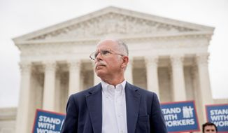 Public employees in New Jersey say a new law forcing them to pay union dues if they don't quickly withdraw from the union contradicts the Supreme Court ruling in favor of plaintiff Mark Janus. (Associated Press)
