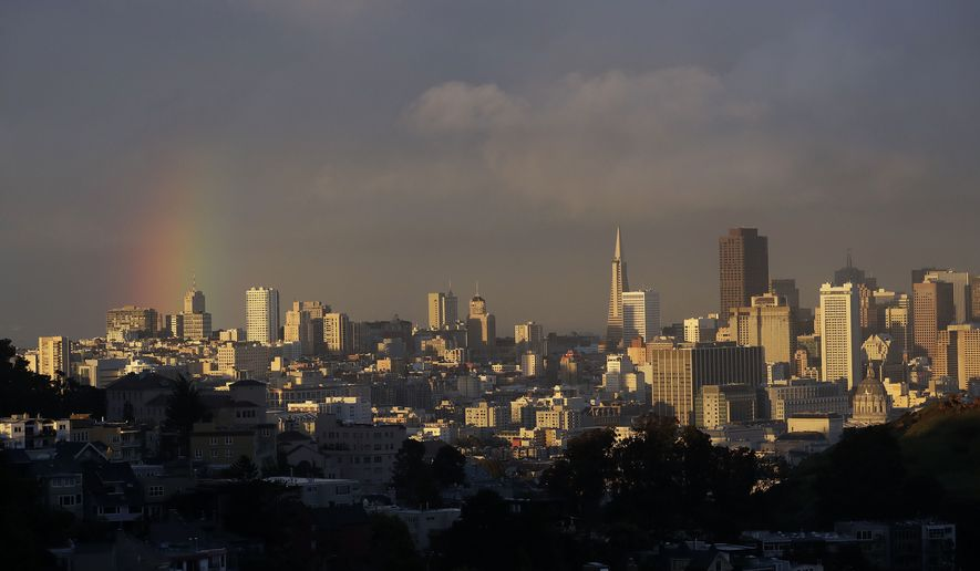 A partial rainbow is shown over the skyline in San Francisco, Friday, March 2, 2018. In Northern California, a blizzard warning was in effect for parts of the Sierra Nevada, and dozens of collisions were reported on San Francisco Bay Area highways. (AP Photo/Jeff Chiu)