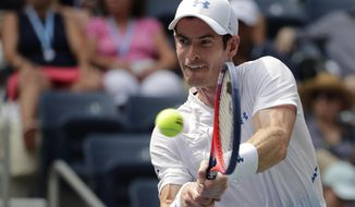 FILE - In this Aug. 27, 2018, file photo, Andy Murray, of Britain, returns a shot to James Duckworth, of Australia, during the first round of the U.S. Open tennis tournament in New York. Three-time major champion Murray is planning to return from hip surgery by competing in doubles at the Queen's Club tournament this month. (AP Photo/Andres Kudacki, File)