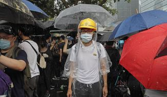 Protestors gather near the Legislative Council in Hong Kong, Wednesday, June 12, 2019. Thousands of protesters blocked entry to Hong Kong's government headquarters Wednesday, delaying a legislative session on a proposed extradition bill that has heightened fears over greater Chinese control and erosion of civil liberties in the semiautonomous territory. (AP Photo/Kin Cheung)