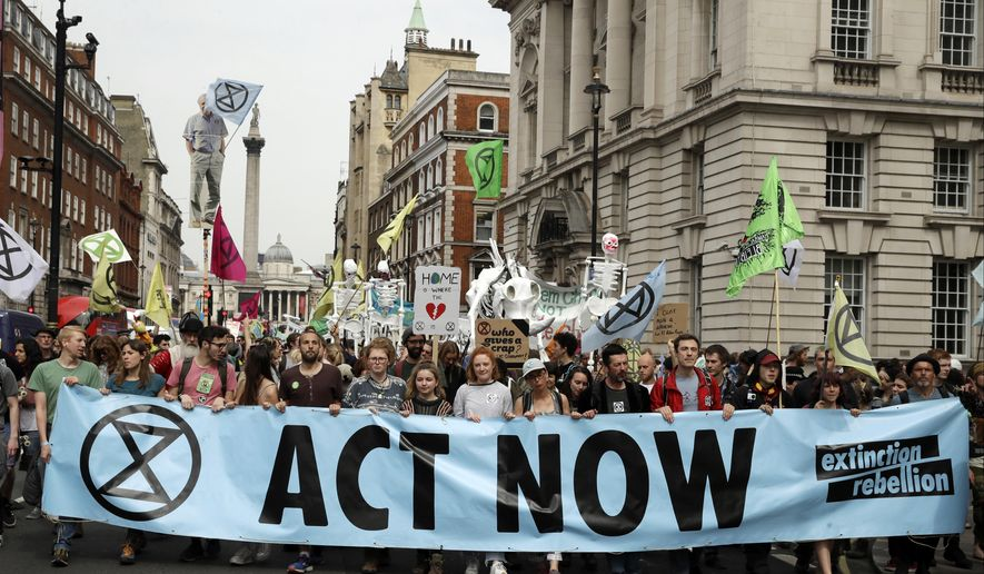 In this Tuesday, April 23, 2019, file photo, climate change protesters march along Whitehall toward Parliament, in London. (AP Photo/Matt Dunham, file)