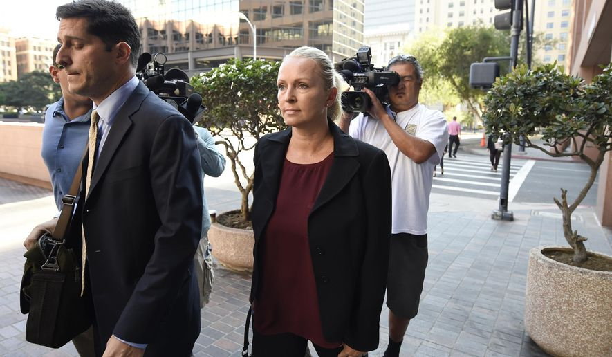 In this Thursday, Aug. 23, 2018, file photo, Margaret Hunter, center, the wife of U.S. Rep. Duncan Hunter, arrives for an arraignment hearing in San Diego. (AP Photo/Denis Poroy) ** FILE **