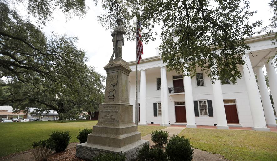 FILE - In this Aug. 1, 2018 file photo, a statue commemorating fallen confederate soldiers stands on front of the East Feliciana Parish Courthouse in Clinton, La. An appeals court on Tuesday, June 11, 2019 rejected a request by Louisiana defendant Ronnie Anderson to have his trial moved from the courthouse with a Confederate monument out front. The one-page ruling gave no reasoning for the decision. (AP Photo/Gerald Herbert, File)
