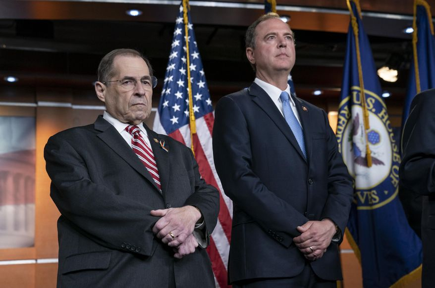 House Judiciary Committee Chairman Jerrold Nadler, D-N.Y., left, and House Intelligence Committee Chairman Adam B. Schiff, D-Calif., pause before taking questions from reporters after passage of a resolution to take legal action against President Donald Trump's administration and potential witnesses, a response to those who defy subpoenas in Congress' Russia probe and other investigations, on Capitol Hill in Washington, Tuesday, June 11, 2019.  (AP Photo/J. Scott Applewhite)