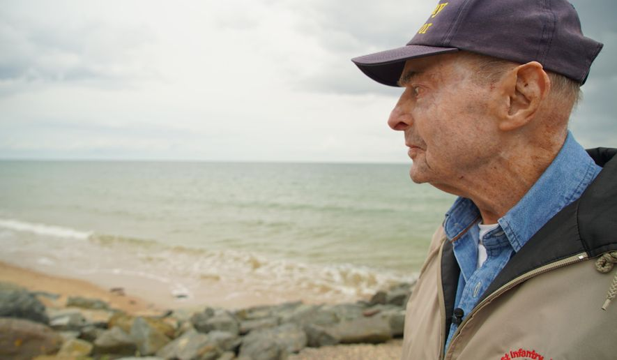 D-Day survivor Ray Lambert looks out over Omaha Beach in Colleville-sur-Mer, France, on Wednesday, June 5, 2019. The North Carolina man was wounded four times on the beach during the Normandy invasion 75 years ago. (AP Photo/Allen G. Breed)