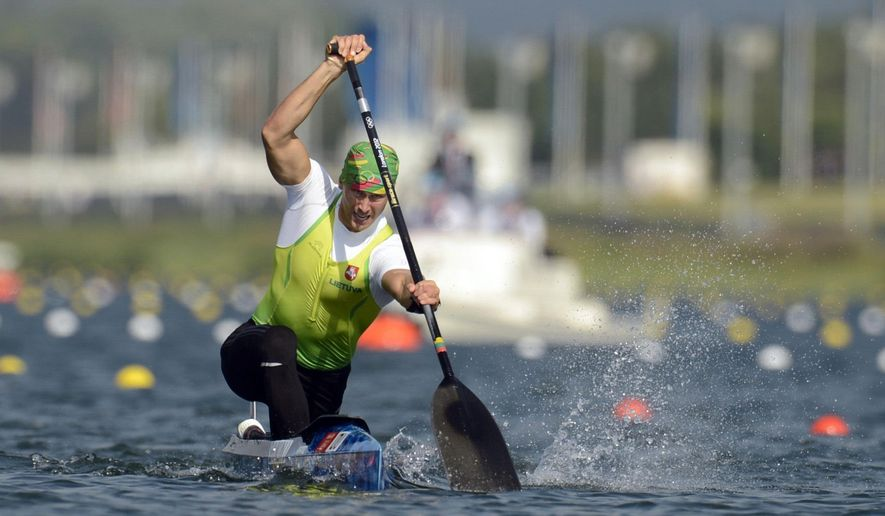 FILE - In this Saturday, Aug. 11, 2012 file photo, Lithuania's Jevgenij Shuklin competes in the men's canoe single 200-meter final at the 2012 Summer Olympics, in Eton Dorney, near Windsor, England. Olympic silver medalist Jevgenij Shuklin has been disqualified from the 2012 London Olympics for doping with an anabolic steroid. The IOC has yet to reallocate medals. (AP Photo/Philip Brown, Pool, File)