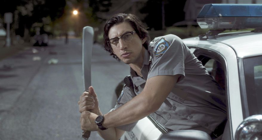 """In this image released by Focus Features shows Adam Driver as """"Officer Ronald Peterson""""  in a scene from """"The Dead Don't Die."""" ( Frederick Elmes /Focus Features via AP)"""