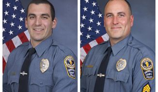 FILE - This combination of undated photos provided by the Gwinnett County Police Department shows Master Police Officer Robert McDonald, left, and Sgt. Michael Bongiovanni in their official portraits. Video from an April 2017 traffic stop in Georgia shows Bongiovanni hitting Demetrius Hollins as he stood with his hands up and McDonald stomping on Hollins' head as he lay on the ground handcuffed. (Gwinnett County Police Department via AP)