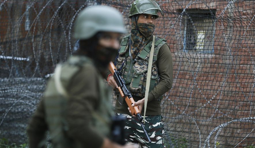 Indian paramilitary soldiers guard in Srinagar, Indian controlled Kashmir, Wednesday, June 12, 2019. Police say rebels fighting against Indian rule in disputed Kashmir have launched an attack on paramilitary soldiers, killing three. One militant also died in the fighting. (AP Photo/Mukhtar Khan)