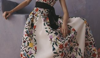 This photo provided by Griffin Marketing and Public Relations and Carolina Herrera shows a model posing for the Carolina Herrera Resort Collection 2020.   The Mexican government accused this week the fashion house Carolina Herrera of cultural appropriation because it incorporated Mexican indigenous elements and embroidery in one of its collections. The fashion house responded Wednesday that it only wanted to pay tribute to the richness of Mexican culture.( Carolina Herrera via AP)