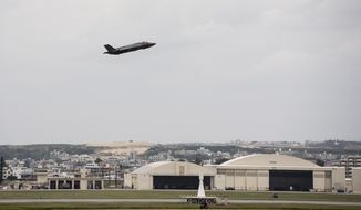 In this Nov. 16, 2017, file photo made available by the U.S. Air Force, a fighter plane takes-off from Kadena Air Base, Japan. The Defense Department has been figuring out how to provide help and justice when the children of service members sexually assault each other on military bases since Congress required reforms in 2018. Those reforms are starting to rollout, but as one current case at Kadena shows, that rollout has been uneven. (Airman 1st Class Greg Erwin/U.S. Air Force via AP)