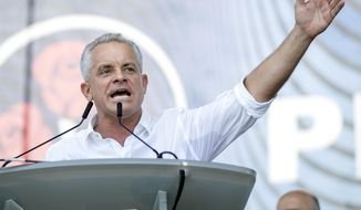 Vladimir Plahotniuc, the leader of the Moldova's Democratic party, and the country's de facto leader, gestures as he addresses a rally, next to interim president Pavel Filip, right, in Chisinau, Moldova, Sunday, June 9, 2019. Moldova's interim president Pavel Filip has dissolved parliament and called for snap elections on Sept. 6 amid a months-long political crisis, announcing his decision shortly after his appointment on Sunday by the Constitutional Court to replace president Igor Dodon who was suspended for not implementing the court's decision on dissolving parliament. (AP Photo/Roveliu Buga)