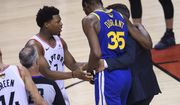 Golden State Warriors forward Kevin Durant (35) leaves after being injured as Toronto Raptors guard Kyle Lowry (7) talks to him during first-half basketball action in Game 5 of the NBA Finals in Toronto, Monday, June 10, 2019. (Nathan Denette/The Canadian Press via AP)