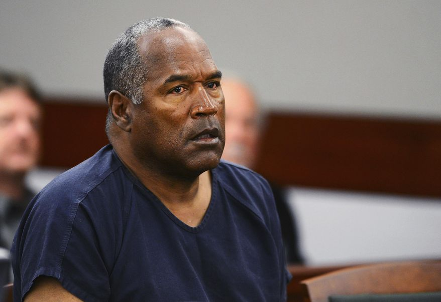 FILE - In this May 14, 2013, file photo, O.J. Simpson appears at an evidentiary hearing in Clark County District Court in Las Vegas. In a letter that surfaced after her 1994 death, Nicole Brown Simpson detailed the fear and violence that framed her marriage to O.J. Simpson. In the 25 years since then, spousal abuse has moved from a private matter to a public health concern. (Ethan Miller via AP, Pool, File)