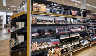 This undated image provided by Ulta Beauty shows makeup products on display at an Ulta Beauty store.  Black and other darker-skinned women had long struggled to find makeup that matched or complemented their skin. But a widening array of products is showing up at mainstream retailers with an eye toward the multicultural consumer. At Ulta, shoppers can try on makeup using its GlamLab app that lets shoppers browse, filter and play around with products. (Vic Moss/Courtesy Ulta Beauty via AP)