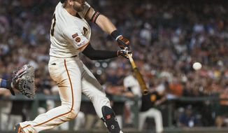 San Francisco Giants' Evan Longoria hits a two-run double against the San Diego Padres in the seventh inning of a baseball game Tuesday, June 11, 2019, in San Francisco. (AP Photo/John Hefti)