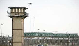 In this Feb. 1, 2017, file photo, a prison guard stands on a towerat a correctional facility in Delaware. (Suchat Pederson/The News Journal via AP, File) **FILE**