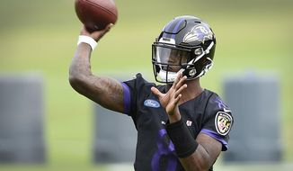 Baltimore Ravens quarterback Lamar Jackson throws a pass at the team's NFL football training facility in Owings Mills, Md., Wednesday, June 12, 2019 (AP Photo/Gail Burton)