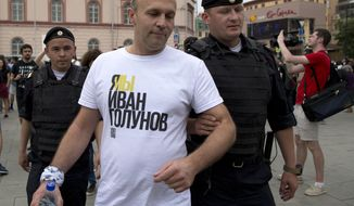 Police officers detain a supporter of Russian investigative journalist Ivan Golunov during a march in Moscow, Russia, Wednesday, June 12, 2019. (AP Photo/Alexander Zemlianichenko)