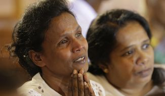 Sri Lanka's Easter Sunday attack survivors attend a holy service at the occasion of reopening of St.Anthony's church, one of the sites that came under attack, in Colombo, Sri Lanka, Wednesday, June 12, 2019.  A Sri Lankan lawmaker says a parliamentary committee will continue questioning security and intelligence officials about lapses that preceded Easter Sunday bomb attacks by Islamic extremists, despite objections by the country's president. (AP Photo/Eranga Jayawardena)