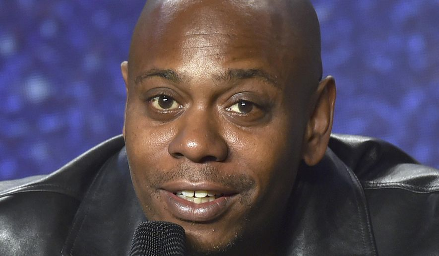 FILE - In this Sept. 9, 2018 file photo, Dave Chappelle speaks at the press conference at the Toronto International Film Festival at the TIFF Bell Lightbox in Toronto. Chappelle will make his Broadway debut this summer but a word of warning: Ditch the cellphone. He will perform five shows at the Lunt-Fontanne Theatre, from July 9, 2019  through July 13.  (Photo by Evan Agostini/Invision/AP, File)