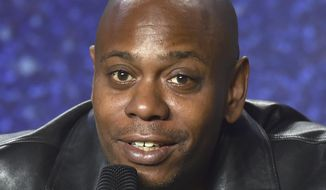 In this Sept. 9, 2018 file photo, Dave Chappelle speaks at the press conference at the Toronto International Film Festival at the TIFF Bell Lightbox in Toronto. Mr. Chappelle on August 25, 2019, will host a benefit concert in southwest Ohio to benefit victims of the recent mass shooting in Dayton. (Photo by Evan Agostini/Invision/AP, File) **FILE**