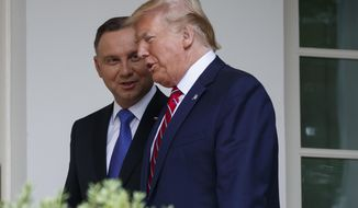 President Donald Trump walks to the Oval Office with Polish President Andrzej Duda at the White House, Wednesday, June 12, 2019, in Washington. (AP Photo/Evan Vucci)