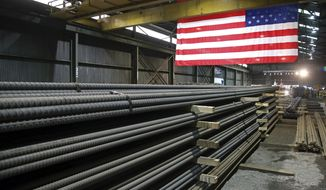 In this May 9, 2019, photo, steel rods produced at the Gerdau Ameristeel mill in St. Paul, Minn. await shipment. Last week's flareup over the Mexico tariffs may prove to be a pivotal juncture. The spat was especially alarming to businesses because it came seemingly out of nowhere. Less than two weeks earlier, President Donald Trump had lifted tariffs on Mexican and Canadian steel and aluminum, action that seemed to signal warmer commercial ties between the United States and its neighbors. (AP Photo/Jim Mone) **FILE**