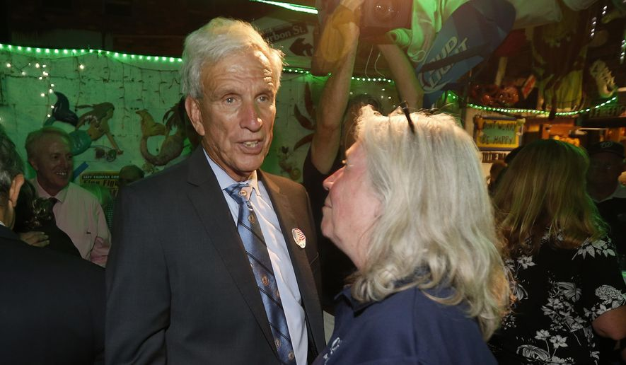 Virginia state Sen. Richard Saslaw, D-Fairfax, greets supporters at an election party in Springfield, Va., Tuesday, June 11, 2019. (AP Photo/Steve Helber)